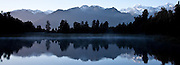 Lake Matheson, early morning sunrise with a view of Mt Cook & Tasman Glacier off to the far right, New Zealand (12x33 inch print)