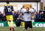 Oxford United forward Kane Hemmings (15) scores a goal to make it 5-0 , Merstham Goalkeeper Phil Wilson shows his frustration during the FA Cup match between Merstham and Oxford United at Moatside, Merstham, United Kingdom on 5 November 2016. Photo by Andy Walter.