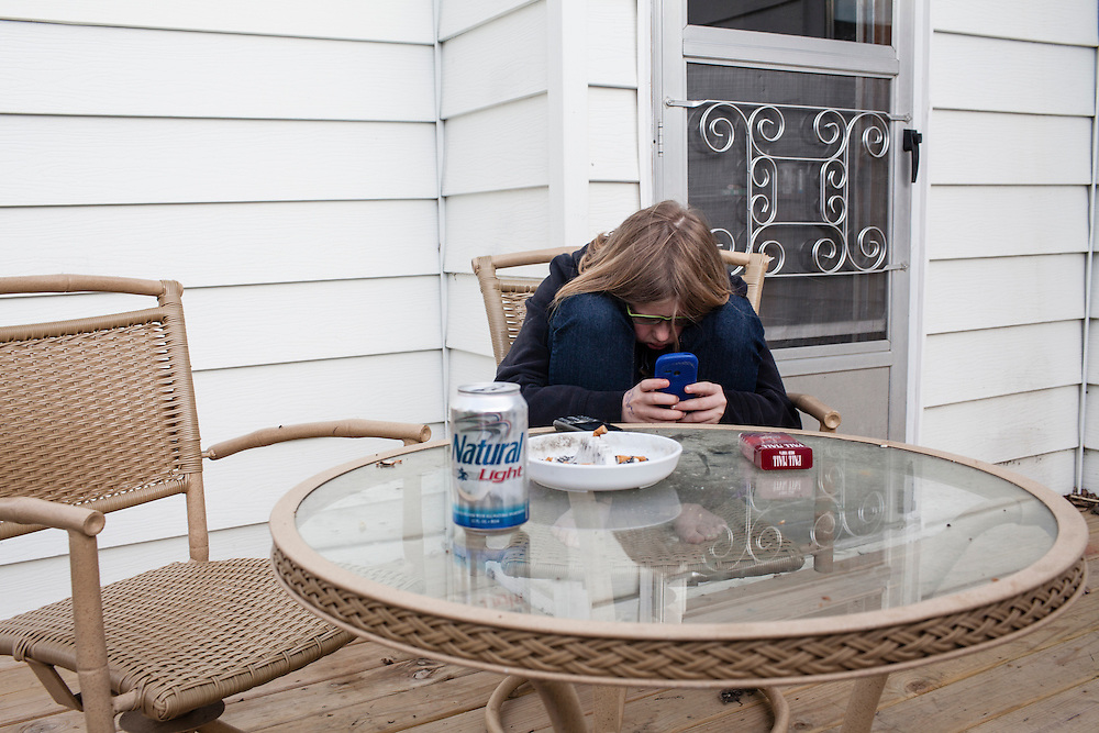 Libby McFarland holds her cell phone on Friday, March 23, 2012 in Webster City, IA.
