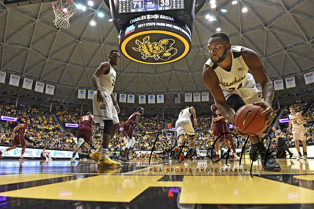 Forward Shaquille Morris #24 of the Wichita State Shockers saves the ball from going out of bounds against the Southern Illinois Salukis during the second half at Charles Koch Arena in Wichita, Kansas.