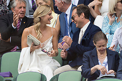 © Licensed to London News Pictures. 12/07/2019. London, UK. Phllipa Law and Jude Law watch centre court tennis in the royal box on Day 11 of the Wimbledon Tennis Championships 2019 held at the All England Lawn Tennis and Croquet Club. Photo credit: Ray Tang/LNP