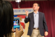 A supporter snaps a camera phone photo of Senator Ted Cruz as he speaks at the South Carolina Tea Party Coalition convention on January 18, 2015 in Myrtle Beach, South Carolina. A variety of conservative presidential hopefuls spoke at the gathering on the third day of a three day event.