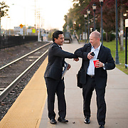 October 17, 2014 - Westwood, N.J. : Democrat Roy Cho, left, bumps elbows with commuter Mark P. Wendrychowicz, center, as he campaigns at the Westwood NJ Transit station on Friday morning. A candidate for Congress from NJ's 5th District, Cho is challenging Rep. Scott Garrett in the upcoming November elections. CREDIT: Karsten Moran for The New York Times