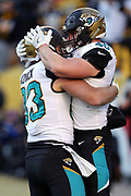 Jacksonville Jaguars fullback Tommy Bohanon (40) celebrates with Jacksonville Jaguars tight end Ben Koyack (83) after catching a 14 yard touchdown pass for a 42-28 fourth quarter Jaguars lead during the NFL 2018 AFC Divisional playoff football game against the Pittsburgh Steelers, Sunday, Jan. 14, 2018 in Pittsburgh. The Jaguars won the game 45-42. (©Paul Anthony Spinelli)