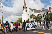 Charleston residents join the Hate Won't Win Unity walk to the Mother Emanuel African Methodist Episcopal Church marking the 2nd anniversary of the mass shooting June 17, 2017 in Charleston, South Carolina. Nine members of the historic African-American church were gunned down by a white supremacist during bible study on June 17, 2015.