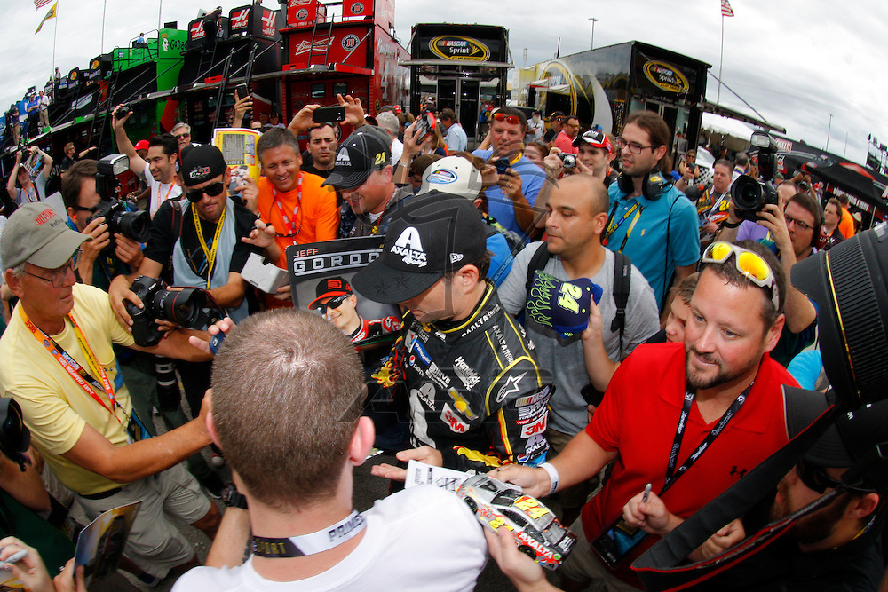 Homestead, FL - Nov 21, 2015: Jeff Gordon (24) signs a few autographs for fans prior to practice for the FORD EcoBoost 400 at Homestead Miami Speedway in Homestead, FL.