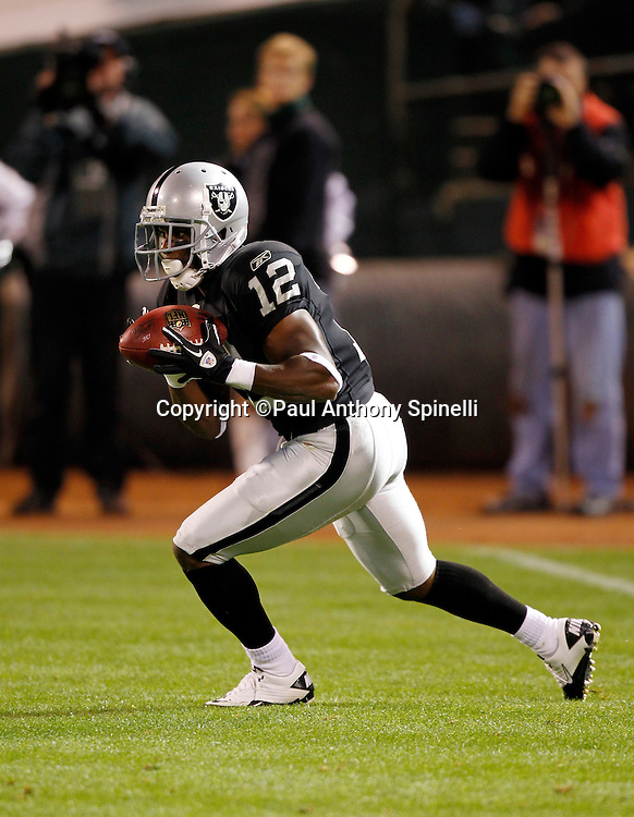 Oakland Raiders kick returner Jacoby Ford (12) returns a kick during the NFL preseason week 3 football game against the San Francisco 49ers on Saturday, August 28, 2010 in Oakland, California. The 49ers won the game 28-24. (©Paul Anthony Spinelli)