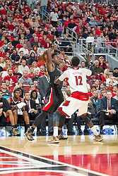 North Carolina State forward Abdul-Malik Abu, left. <br /> <br /> The University of Louisville hosted the North Carolina State, Saturday, Feb. 14, 2015 at the Yum Center in Louisville. NC State won 74-65.<br /> <br /> Photo by Jonathan Palmer