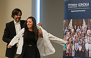 Medical students in the new UW School of Medicine-GU Regional Health Partnership take part in the white coat ceremony. (Photo by Edward Bell)