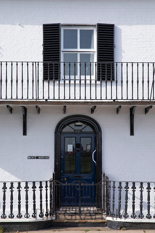 Moot House Grade II listed building with wrought iron railings and wooden shutters in Aldeburgh, Suffolk, England, UK