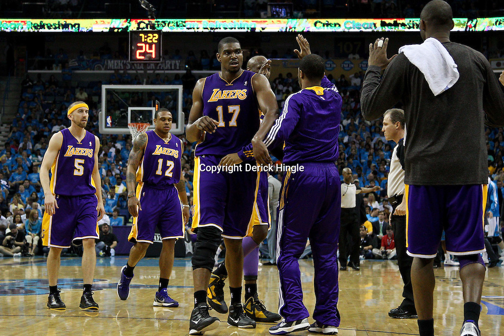 April 28, 2011; New Orleans, LA, USA; Los Angeles Lakers center Andrew Bynum (17) celebrates with teammates during the fourth quarter in game six of the first round of the 2011 NBA playoffs against the New Orleans Hornets at the New Orleans Arena. The Lakers defeated the Hornets 98-80 to advance to the second round of the playoffs.   Mandatory Credit: Derick E. Hingle