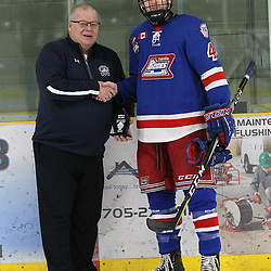 COCHRANE, ON - MAY 2: NOJHL Commissioner Robert Mazzuca presents the player of the game award to  Cameron Hatziioannov #44 of the Oakville Blades on May 2, 2019 at Tim Horton Events Centre in Cochrane, Ontario, Canada.<br /> (Photo by Tim Bates / OJHL Images)