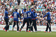 England players celebrate the wicket of New Zealand Brendon McCullum for 39 during the Royal London One Day International match between England and New Zealand at the Oval, London, United Kingdom on 12 June 2015. Photo by Phil Duncan.