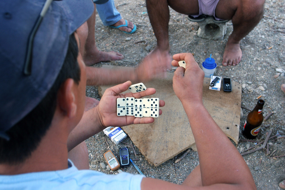CHIOS, GREECE: Men playing domino at a beach in Chios Island, Greece.