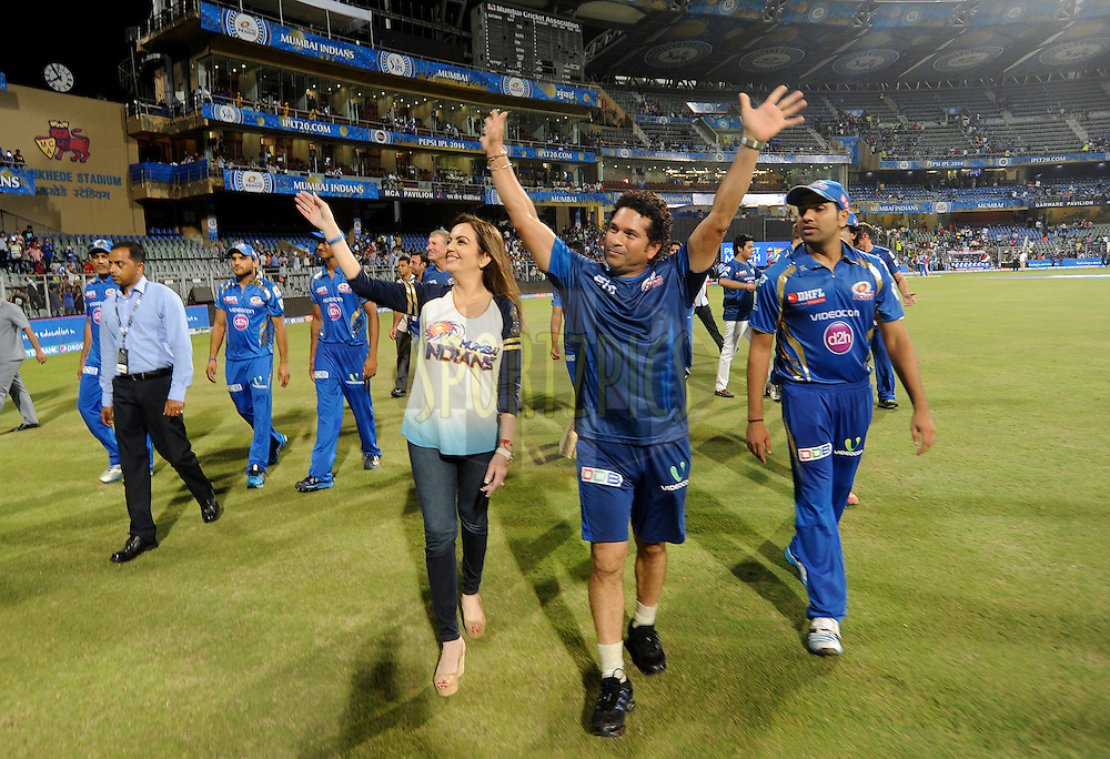 Nita Ambani owner of the Mumbai Indians along with Sachin Tendulkar 'Icon' Mumbai Indians and Rohit Sharma captain of the Mumbai Indians wave at the Under Privilege children as they take a lap of the ground with the team after match 22 of the Pepsi Indian Premier League Season 2014 between the Mumbai Indians and the Kings XI Punjab held at the Wankhede Cricket Stadium, Mumbai, India on the 3rd May  2014<br /> <br /> Photo by Pal Pillai / IPL / SPORTZPICS<br /> <br /> <br /> <br /> Image use subject to terms and conditions which can be found here:  http://sportzpics.photoshelter.com/gallery/Pepsi-IPL-Image-terms-and-conditions/G00004VW1IVJ.gB0/C0000TScjhBM6ikg