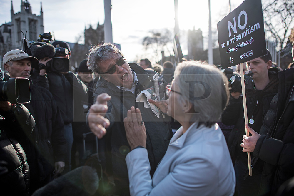 © Licensed to London News Pictures. 26/03/2018. London, UK. A heated debate between a members of the Jewish community and supporters of Jeremy Corbyn as Members of the Jewish community and Jewish leaders hold a demonstration outside the Houses of Parliament in London against Jeremy Corbyn, who they accuse of not acting on anti-semitic behaviour in the Labour Party. Photo credit: Ben Cawthra/LNP