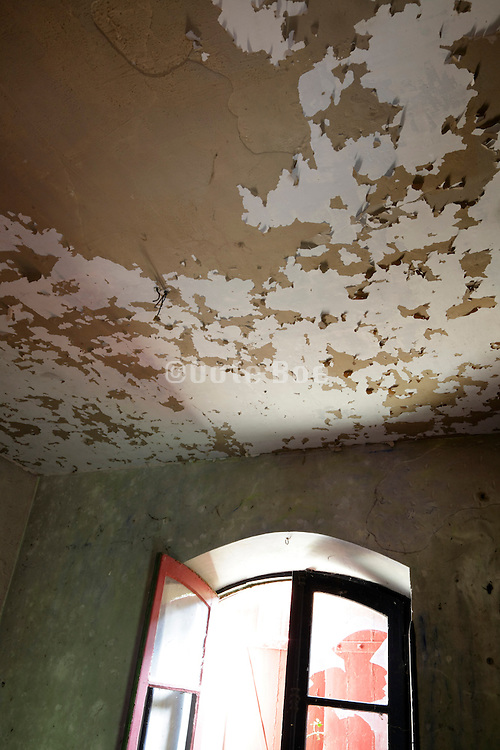 ceiling with peeling paint in abandoned house