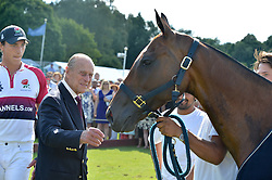 HRH The DUKE OF EDINBURGH at The Royal Salute Coronation Cup Polo held at Guards Polo Club,  Smiths Lawn, Windsor Great Park, Egham on 23rd July 2016.