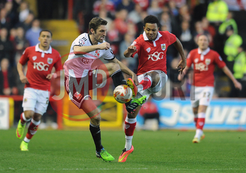 Swindon Town's Sam Ricketts challenges for the ball with Bristol City's Korey Smith - Photo mandatory by-line: Dougie Allward/JMP - Mobile: 07966 386802 - 07/04/2015 - SPORT - Football - Bristol - Ashton Gate - Bristol City v Swindon Town - Sky Bet League One