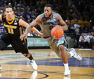 MANHATTAN, KS - FEBRUARY 26:  Guard Jacob Pullen #0 of the Kansas State Wildcats drives against guard Michael Dixon #11 of the Missouri Tigers during the second half on February 26, 2011 at Bramlage Coliseum in Manhattan, Kansas.  Kansas State defeated Missouri 80-70.  (Photo by Peter G. Aiken/Kansas State/Getty Images) *** Local Caption *** Jacob Pullen;Michael Dixon