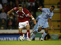 Photo: Rich Eaton.<br /> <br /> Bristol City v Manchester City. Carling Cup. 29/08/2007. Bristol City's Michael McIndoe shields the ball from Michal Ball of Man City.