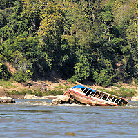 Slow Boat Capsized on Rocks in Luang Prabang, Laos<br />