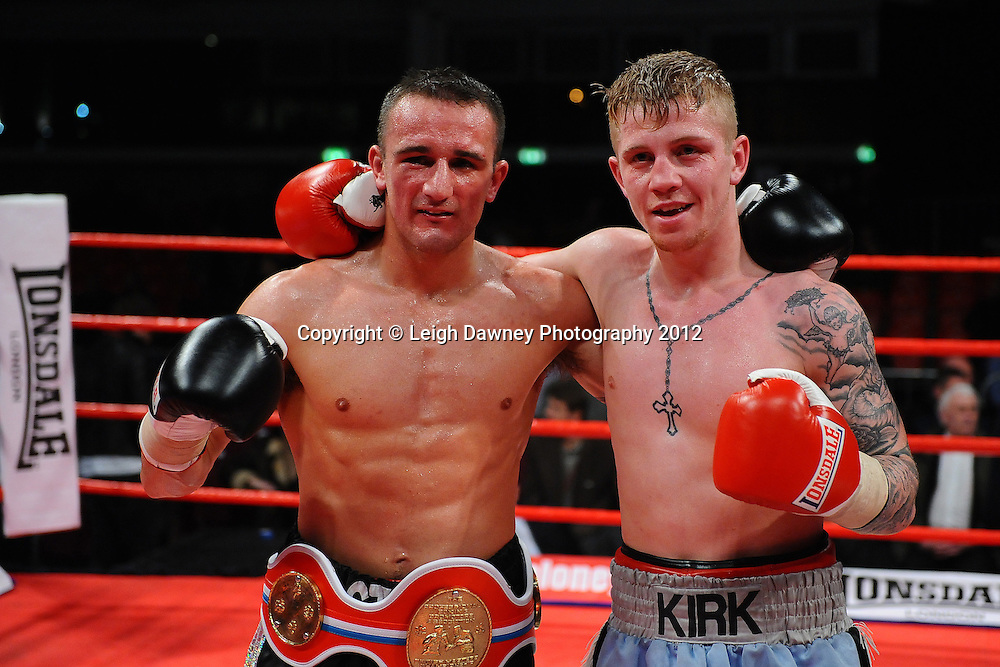 Steve Williams (black shorts) defeats Kirk Goodings in a 12x3 bout for the Vacant British Masters Light Welterweight Title on the 30th November 2012 at Aintree Equestrian Centre, Aintree, Liverpool. Frank Maloney Promotions. Pictures by Leigh Dawney. ©leighdawneyphotography 2012.