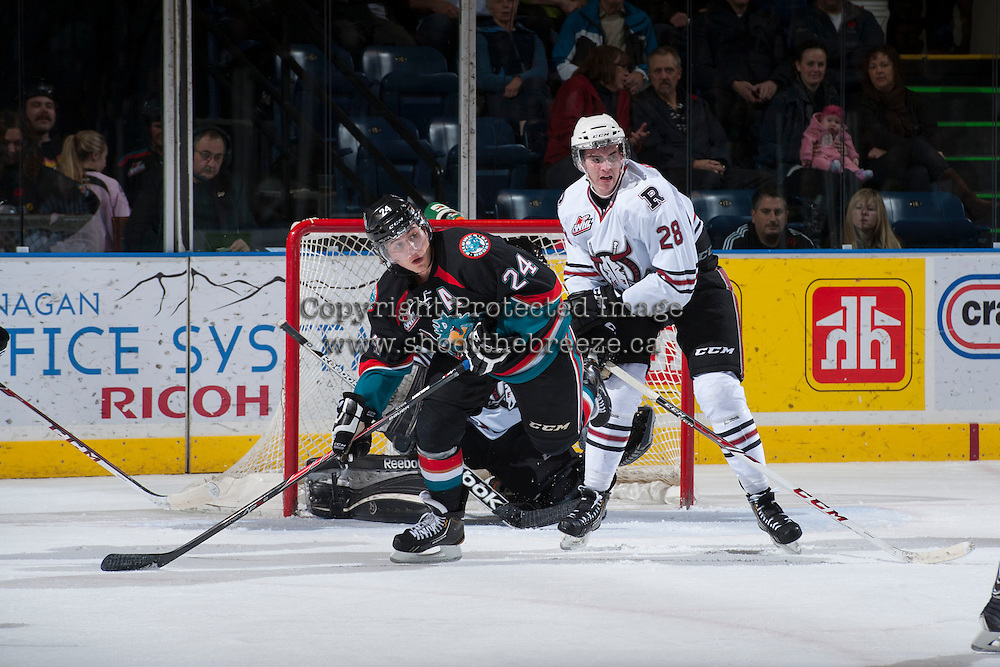 KELOWNA, CANADA - NOVEMBER 6: Tyson Baillie #24 of the Kelowna Rockets gets checked by Kolton Dixon #28 of the Red Deer Rebels on NOVEMBER 6, 2013 at Prospera Place in Kelowna, British Columbia, Canada.   (Photo by Marissa Baecker/Shoot the Breeze)  ***  Local Caption  ***
