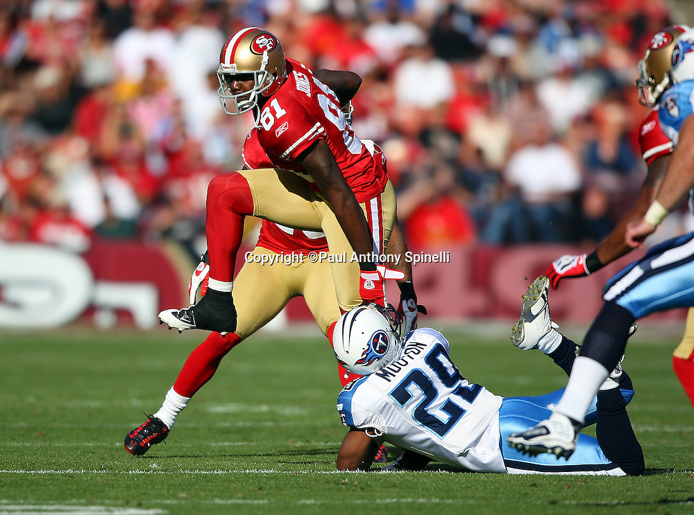 San Francisco 49ers punt returner Brandon Jones (81) leaps out of the grasp while trying to avoid a tackle by Tennessee Titans Ryan Mouton (29) during the NFL football game against the Tennessee Titans, November 8, 2009 in San Francisco, California. The Titans won the game 34-27. (©Paul Anthony Spinelli)