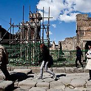 Tourists walk past damaged areas of Pompeii.Nearly 4 months after the collapse of the House of the Gladiators and then of a wall at the House of the Moralist, Pompeii still faces neglet and mismanagement.Now the Italian government has begun to investigate the matter. Nine people are to be questioned, although Marcello Fiori, the emergency commissioner who was appointed to save the site in 2008, is conspicuously absent from the group.Those who will be grilled by the public prosecutor include the former superintendent of Naples and Pompeii, the site director who oversaw the waterproofing of the House of the Gladiators, the head of technical services at Pompeii, and an architect. The investigation will also examine Fiori's administration, which ended in July, including its use of government funds, which many critics have seen as wasteful and ineffective.