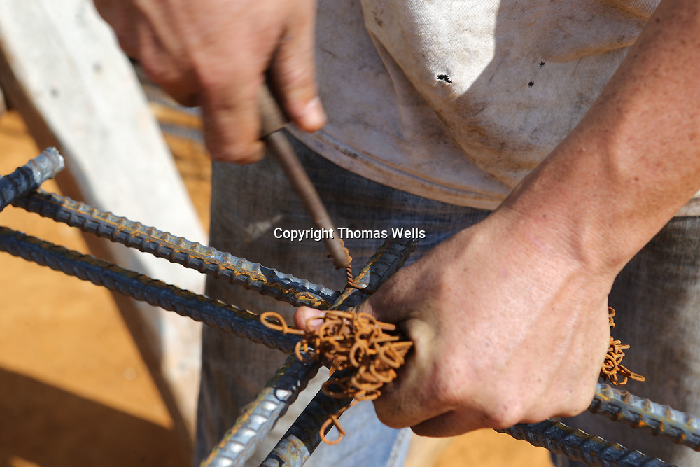 Metal wiring is used to secure precut sections of metal rods to form the rebar for the footings for the new Tupelo-Lee County Humane Society Animal Shelter.