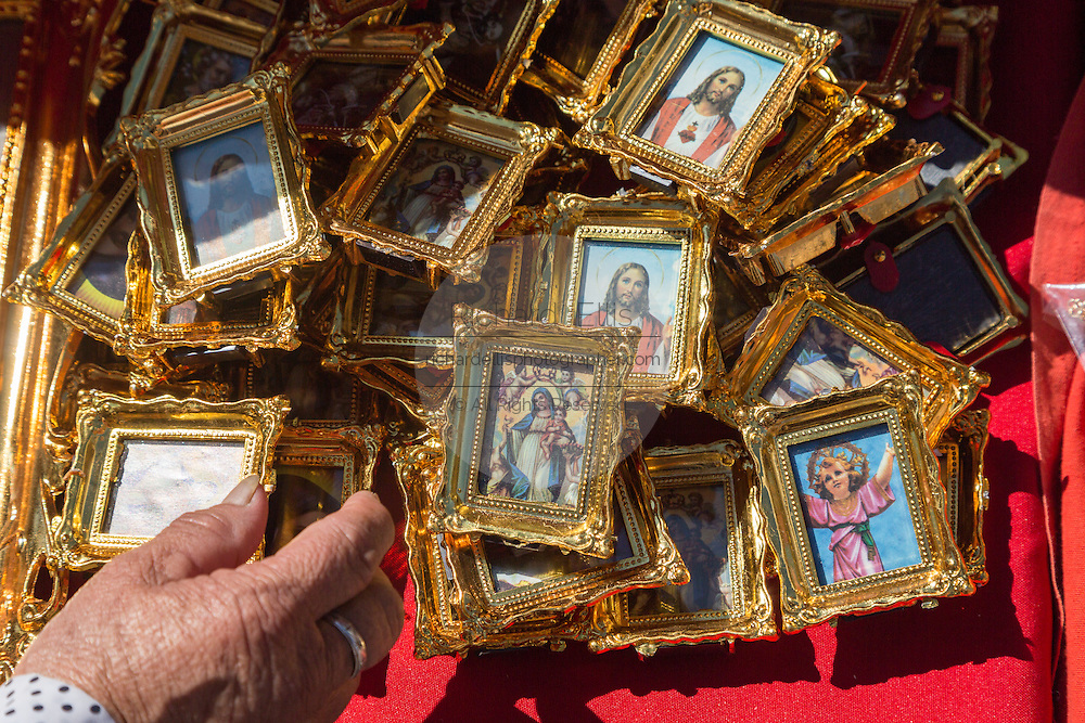 Religious icons and images of saints on sale for Mexican pilgrims and penitents at the Sanctuary of Atotonilco an important Catholic shrine in Atotonilco, Mexico.