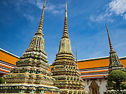 11 AUGUST 2016 - BANGKOK, THAILAND:  The spires of chedis at Wat Pho in Bangkok. Wat Pho (the Temple of the Reclining Buddha), is formally known as Wat Phra Chetuphon. It's one of the largest temple complexes in Bangkok and best known for the giant reclining Buddha that measures 46 metres long and is covered in gold leaf. There is also a large ordination hall and the best known massage school in Thailand on the temple grounds.       PHOTO BY JACK KURTZ