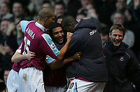 Photo: Lee Earle.<br /> West Ham United v Sheffield United. The Barclays Premiership. 25/11/2006. West Ham's Hayden Mullins (C) is congratulated after scoring their opening goal.