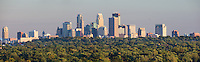 Panoramic summer view of the Minneapolis skyline from its Northwest suburbs.