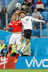 June 19, 2018 - Saint Petersburg, Russia - Sergey Ignashevich (L) of Russia national team and Amr Warda of Egypt national team vie for a header during the 2018 FIFA World Cup Russia group A match between Russia and Egypt on June 19, 2018 at Saint Petersburg Stadium in Saint Petersburg, Russia. (Credit Image: © Mike Kireev/NurPhoto via ZUMA Press)
