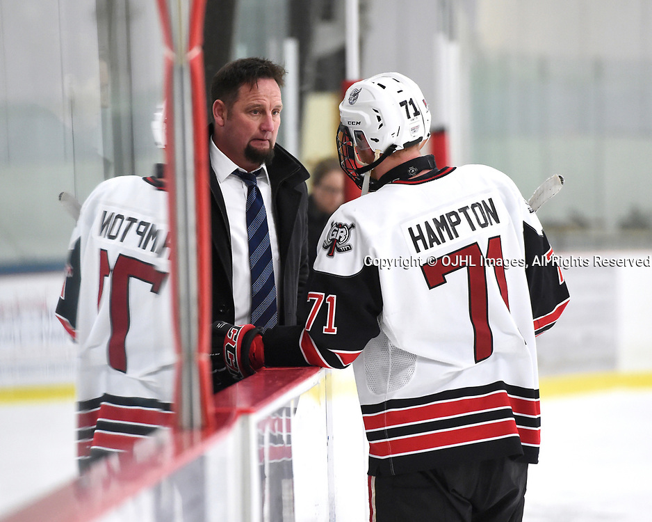 GEORGETOWN, ON - APR 18,  2017: Ontario Junior Hockey League, Championship Series. Georgetown Raiders vs the Trenton Golden Hawks in Game 3 of the Buckland Cup Final.  Georgetown Raiders Head Coach Greg Walters speaks with Jonathan Hampton #71 after the game.<br /> (Photo by Andy Corneau / OJHL Images)