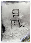 eroding glass plate photo of a toddler standing by chair