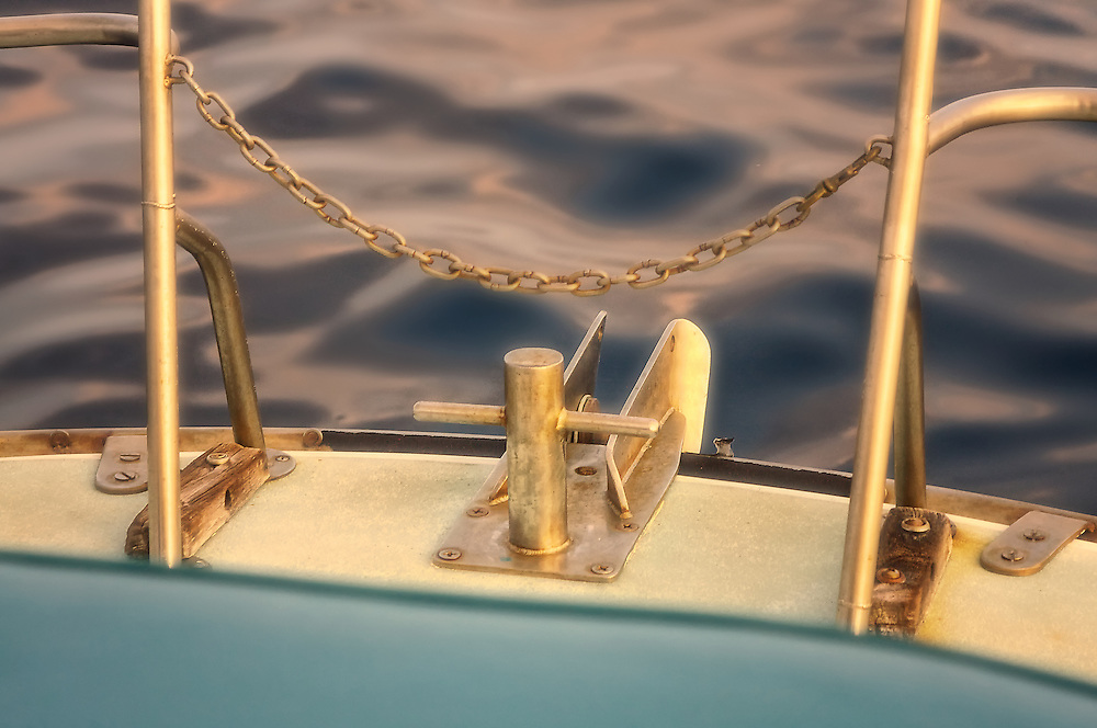 Close-up detail of sailboat on the ocean.
