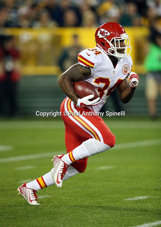 Kansas City Chiefs running back and kick returner Knile Davis (34) returns a first quarter kick off 54 yards during the 2015 NFL week 3 regular season football game against the Green Bay Packers on Monday, Sept. 28, 2015 in Green Bay, Wis. The Packers won the game 38-28. (©Paul Anthony Spinelli)