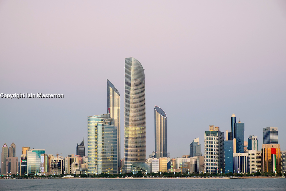 Skyline of modern buildings along Corniche waterfront in Abu Dhabi United Arab Emirates
