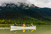 Canoeing on Mendenhall Lake on a glacier paddle & trek trip with Above & Beyond Alaska to hike on Mendenhall Glacier, Juneau, Alaska USA.