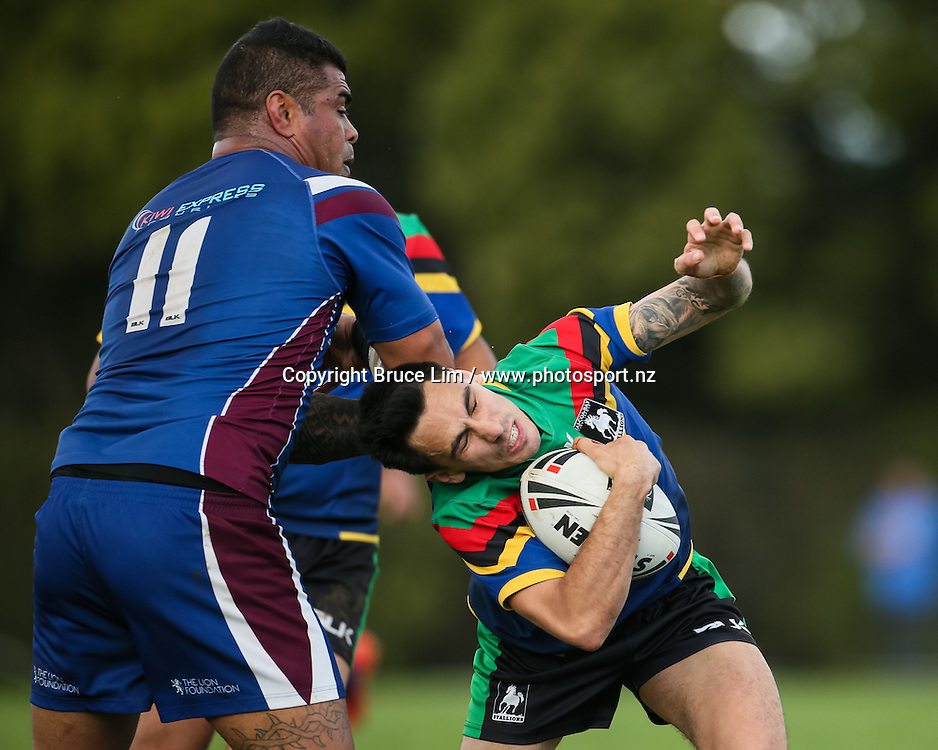 Wai-Coa-Bay Stallions five-eighth Malcome Noda is hit in a high tackle from Akarana Falcons second rower Saimone Makahili during the NZRL Premiership rugby league match - Wai-Coa-Bay Stallions v Akarana Falcons at Resthills Park, Hamilton on Saturday 19 September 2015. <br /> <br /> Copyright Photo:  Bruce Lim / www.photosport.nz