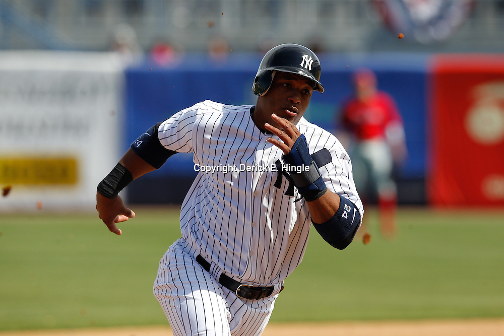 March 4, 2012; Tampa Bay, FL, USA; New York Yankees second baseman Robinson Cano (24) runs for home on a RBI double by third baseman Alex Rodriguez (not pictured) during spring training game against the Philadelphia Phillies at George M. Steinbrenner Field. Mandatory Credit: Derick E. Hingle-US PRESSWIRE