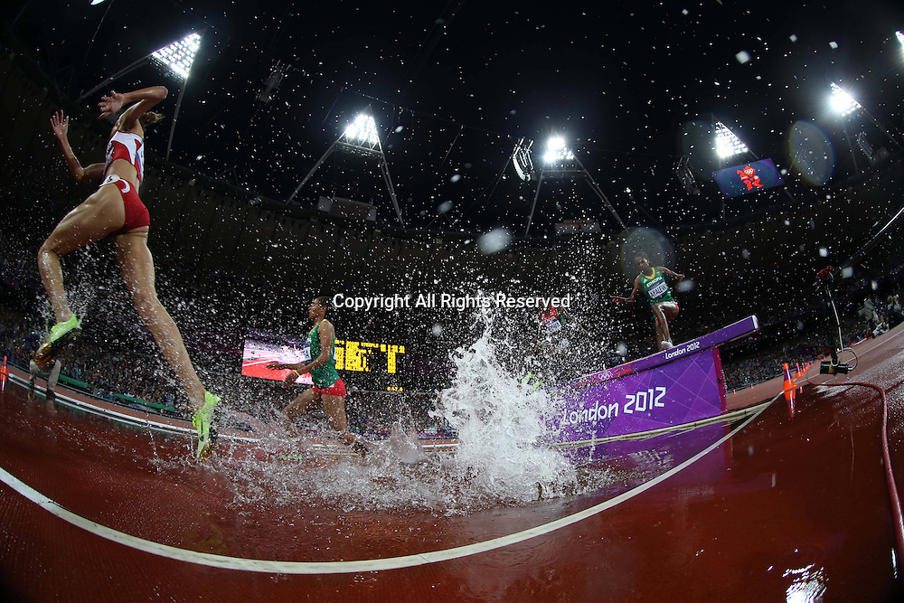 06.08.2012. Greenwich Park, London, England. Athletes compete at the water jump during Womens 3000m Steeplechase Final Match  London 2012 Olympic Games Yuliya Zaripova of Russia Won Gold Medal