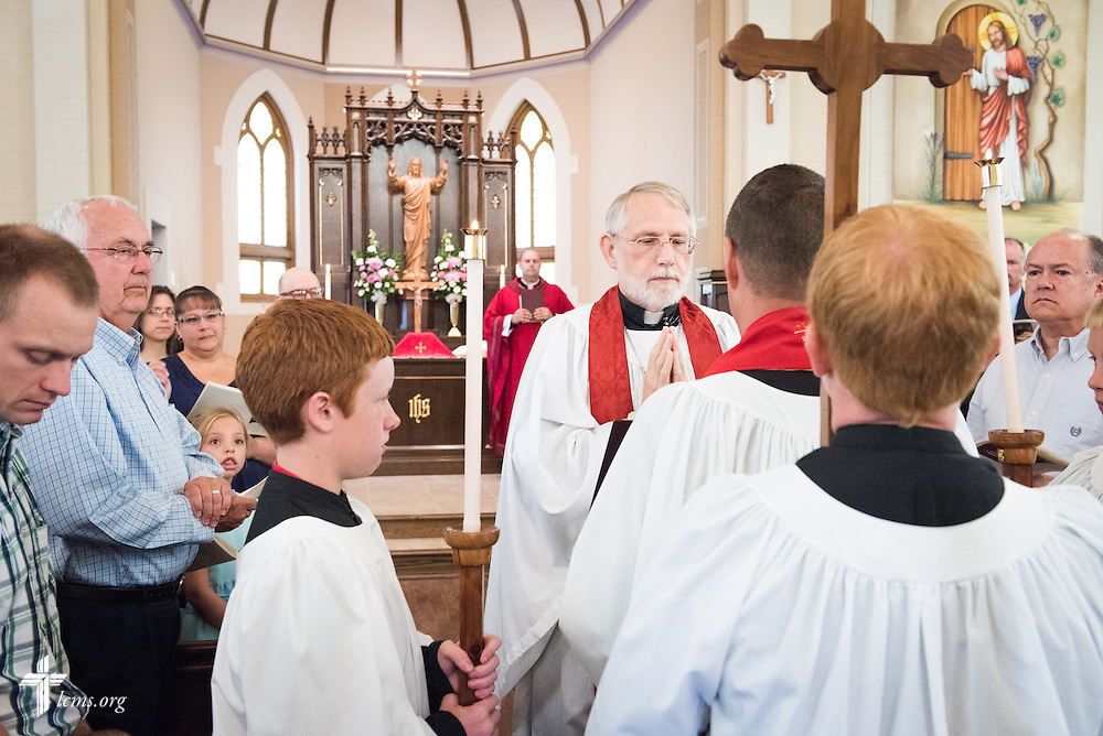 The Rev. William Gleason reads the Holy Gospel during a Divine Service of Rededication at St. Paul Lutheran Church in Hamel, Ill., on Sunday, Sept. 7, 2014. LCMS Communications/Erik M. Lunsford