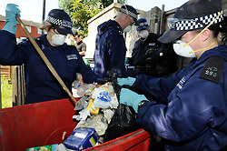 © Licensed to London News Pictures. 09/08/2012 .Day 6 missing 12 year old Tia Sharp..Police search teams searching every rubbish bin on The Lindens this morning...12 years old Tia Sharp has been missing from the Lindens on The Fieldway Estate in New Addington,Croydon,Surrey since Friday last week. .Photo credit : Grant Falvey/LNP