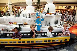 23 November 2012. New Orleans, Louisiana,  USA. <br /> Christmas time at the Mall. Kids ride the Christmas Grotto train on Black Friday.<br /> Photo; Charlie Varley/varleypix.com