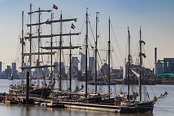 Woolwich, London, September 14th 2016. The late afternoon sun reflects off the hulls and spars of tall ships gathered for the Sail Greenwich Festival 2016 on the River Thames at Woolwich.  &copy;Paul Davey<br /> FOR LICENCING CONTACT: Paul Davey +44 (0) 7966 016 296 paul@pauldaveycreative.co.uk