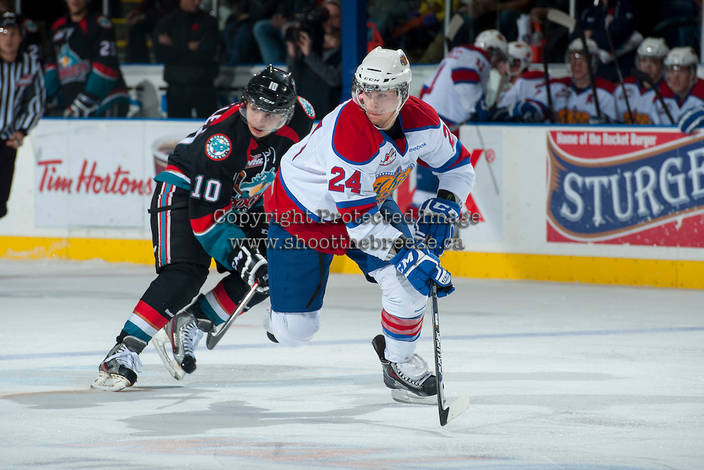 KELOWNA, CANADA - NOVEMBER 9: Aaron Irving #24 of the Edmonton Oil Kings is checked by Nick Merkley #10 of the Kelowna Rockets during first period action on November 9, 2013 at Prospera Place in Kelowna, British Columbia, Canada.   (Photo by Marissa Baecker/Shoot the Breeze)  ***  Local Caption  ***
